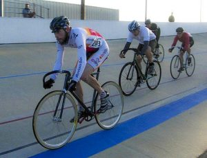 A-velodrome-racer-rides-a-fixed-gear-bike-with-the-Zephyr-track-fork-made-in-the-USA-by-Wound-Up-Composite-cycles