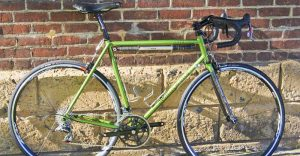 Aaron Dykstra Six Eleven Bicycle Co green bike with Wound Up Composite Cycles fork