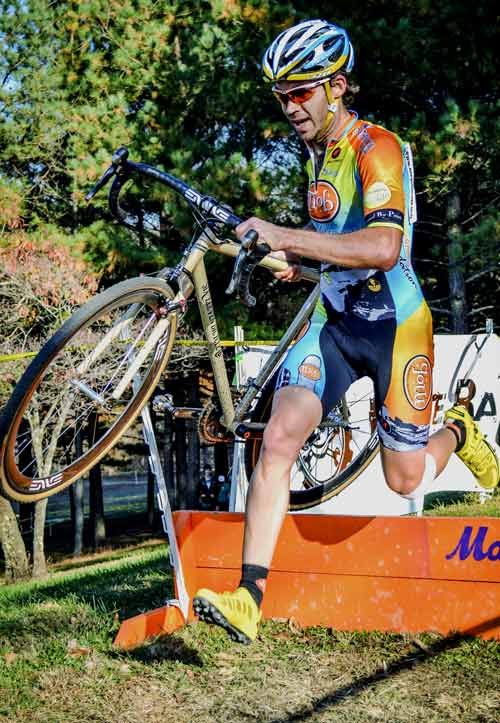Cyclocross racer Beeson carries Six Eleven CX bike with Wound Up Composite Cycles carbon fiber Team X fork
