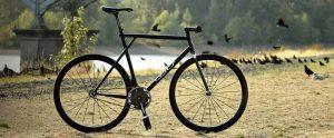 Amy Dangers black GT fixie with carbon fiber Wound Up Composite Cycles carbon fiber Zephyr track fork